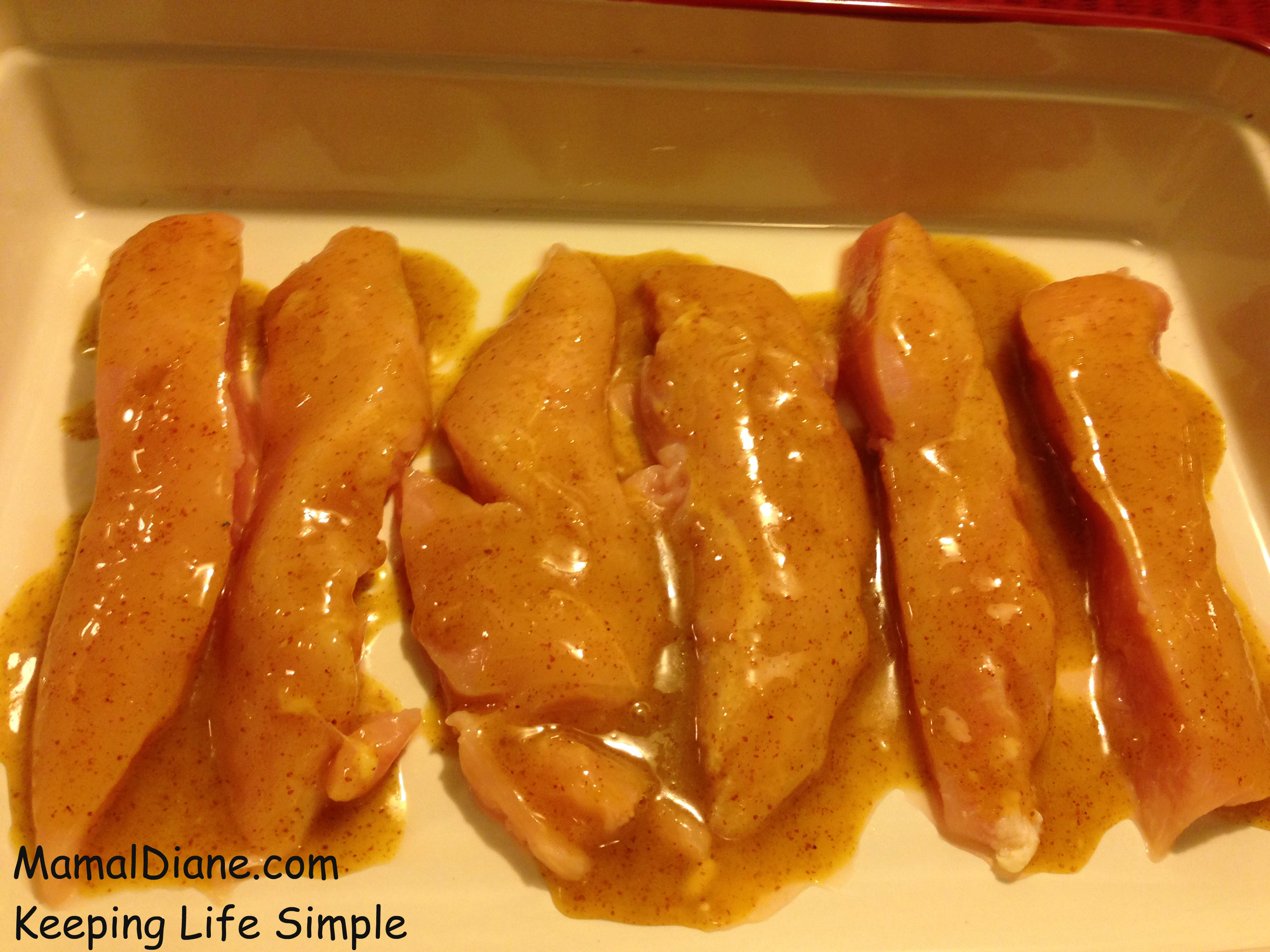 ... bacon slices and cut them in half. Place them on top of your chicken