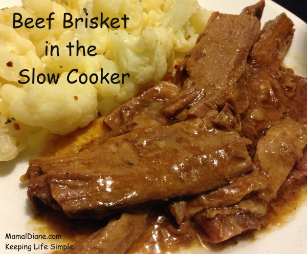 Beef Brisket with gravy on a plate with cauliflower