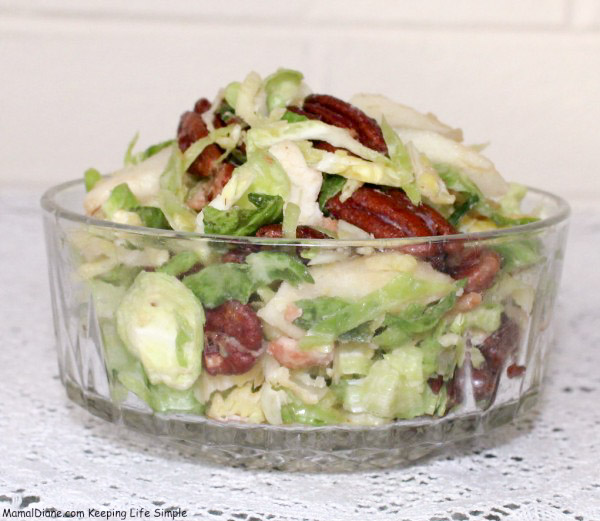 Sliced-Brussels-Sprouts-with-Bacon-Vinaigrette-2-e1419686474215 (1)